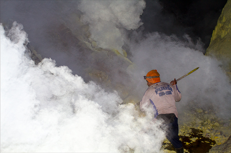 Workers mine sulfur from the volcano