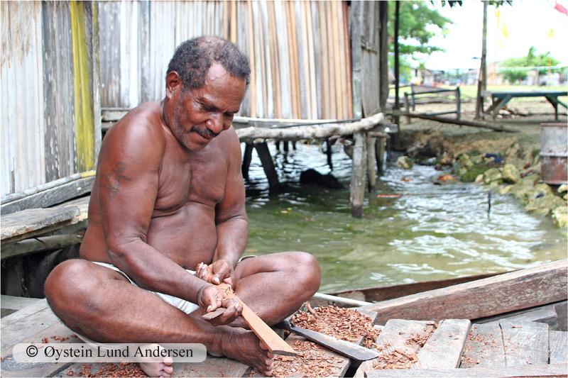 The Babrongko village chief carving a spoon.