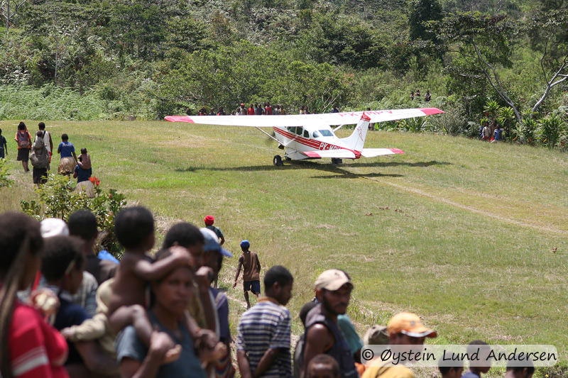 The arrival of a missionary airplane (MAF) stirs curiosity.