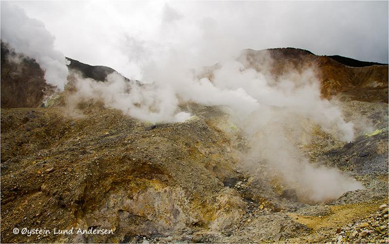 Heavy steaming from fumarolic activity at the kawah mas crater, and the kawah baru crater behind.