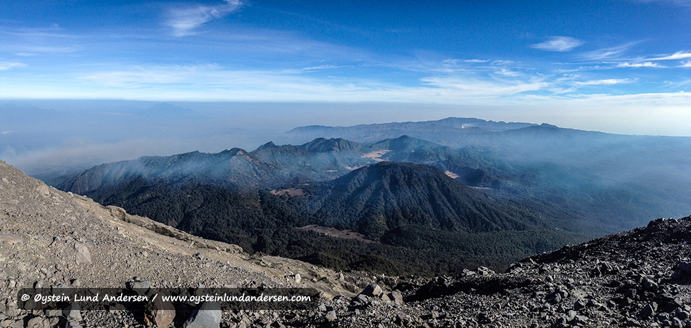 Panorama view towards the Bromo-Tengger-Semeru national park. Bromo steaming in the far distance.
