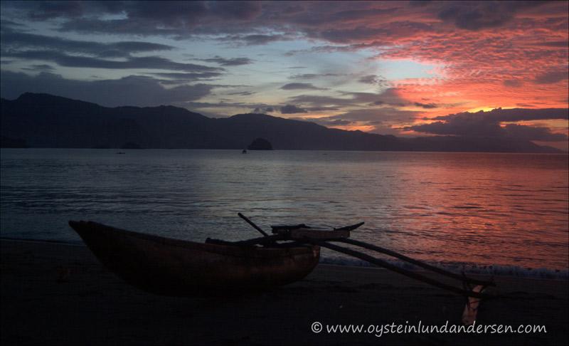 Canoe at beach during sunset. (September 2004)