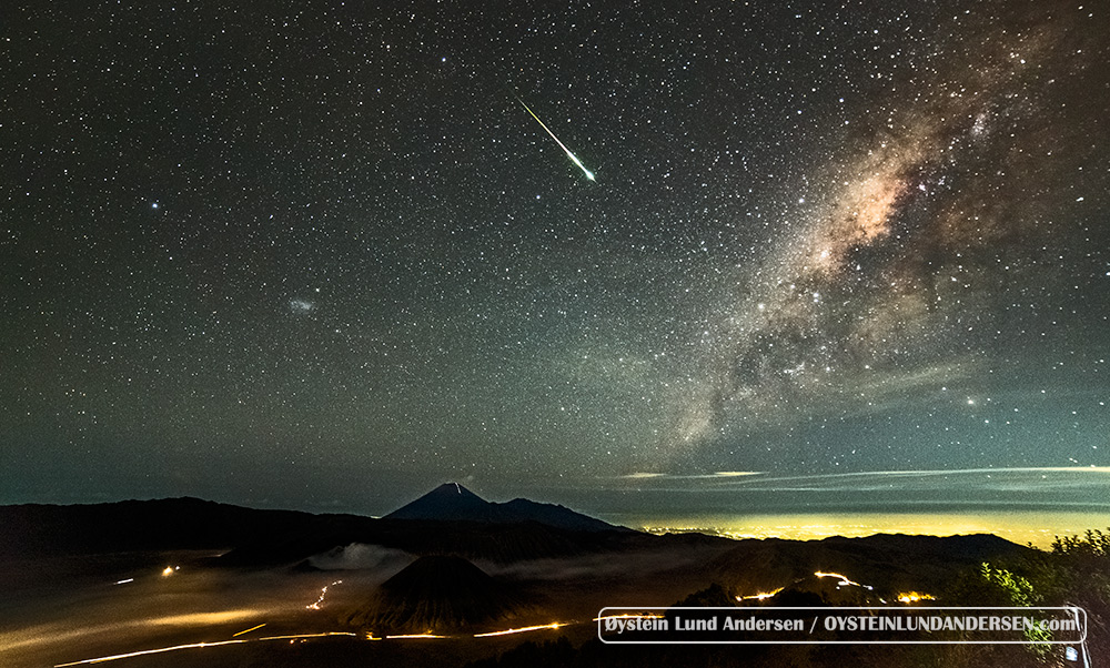 A meteorite strikes over the Tengger Caldera, Semeru in the background.