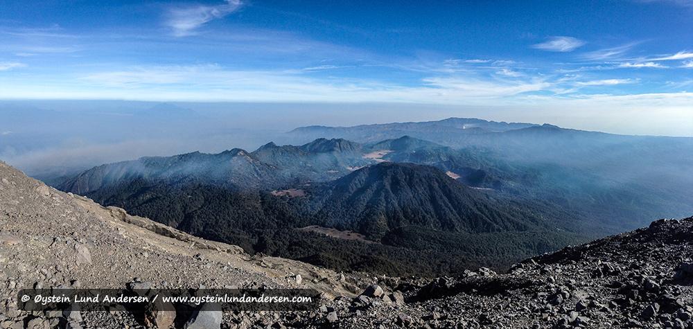 Panorama view towards the Bromo-Tengger-Semeru national park. Bromo steaming in the far distance.