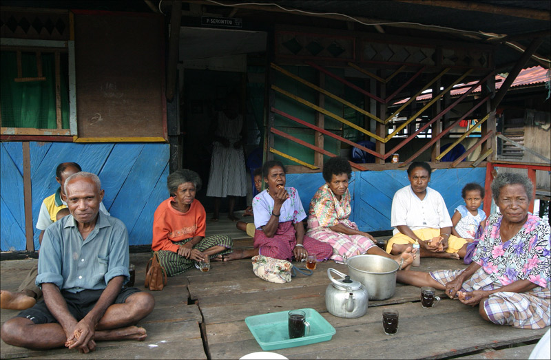 Village gathering after a funeral. (August 2006)