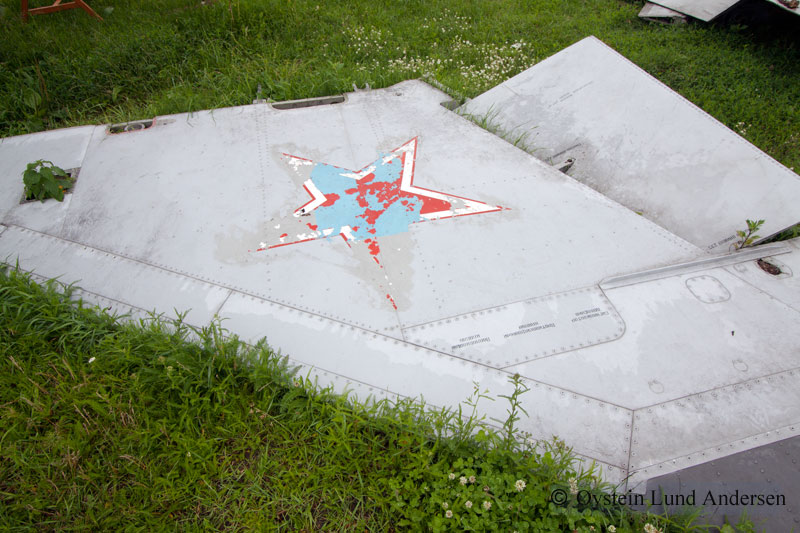 The end of an Soviet era. Part of tail-section of a fighter jet.